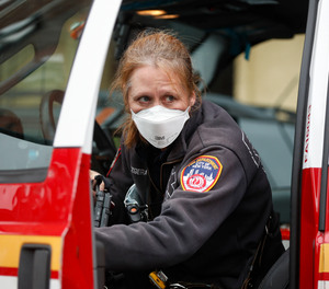 An FDNY medical worker wears personal protective equipment outside a COVID-19 testing site at Elmhurst Hospital Center, Wednesday, March 25, 2020, in New York.