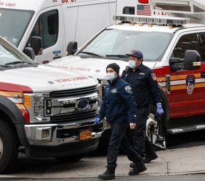 FDNY EMS providers wear personal protective equipment outside a COVID-19 testing site at Elmhurst Hospital Center, Wednesday, March 25, 2020. The FDNY confirmed Wednesday that 84 members of the department have now tested positive for COVID-19, nearly twice the amount confirmed as of Tuesday.