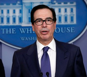 Treasury Secretary Steven Mnuchin speaks about COVID-19 on March 25, 2020, in Washington. Mnuchin said hazard pay for first responders and healthcare workers could be included in future stimulus legislation.