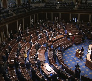 In this image from video, members of the House stand after they passed the coronavirus stimulus package on the floor of the House of Representatives at the U.S. Capitol in Washington, Friday, March 27, 2020. A House representative has proposed a three-month tax holiday for first responders during the COVID-19 pandemic. (Photo/House Television via AP)