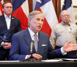 This photo shows Texas Gov. Greg Abbott announcing the building of a 250-bed hospital during a press conference at the Texas State Capitol in Austin, Sunday, March 29, 2020. Abbott is suspending some EMS certification, testing and licensure requirements in order to increase the state's EMS workforce during the COVID-19 crisis.