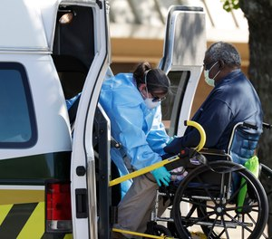 A resident at the Southeast Nursing and Rehabilitation Center is loaded into an ambulance in San Antonio, Wednesday, April 1, 2020.