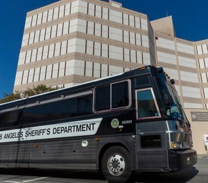 A Los Angeles County Sheriff's Department prisoner transportation bus leaves the Twin Towers Correctional Facility in Los Angeles on Wednesday, April 1, 2020. California plans to release inmates due to be paroled to free space in prisons in anticipation of a coronavirus outbreak. (AP Photo/Damian Dovarganes)