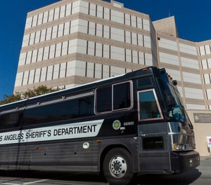A Los Angeles County Sheriff's Department prisoner transportation bus leaves the Twin Towers Correctional Facility in Los Angeles on Wednesday, April 1, 2020. California plans to release inmates due to be paroled to free space in prisons in anticipation of a coronavirus outbreak.