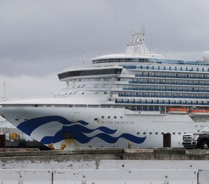 In this March 15, 2020, file photo, the Grand Princess cruise ship is shown docked at the Port of Oakland in Oakland, Calif. Two passengers, including retired Dallas Firefighter Michael Dorety, and a crew member on board the ship have died from COVID-19, while at least 103 tested positive for the coronavirus.