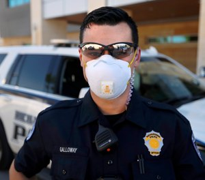 Richardson police officer Austin Galloway is pictured at the start of his shift, Wednesday, April 8, 2020. Mask and gloves are part of their daily routine amid concerns of the COVID-19 crisis.