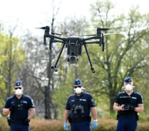 Police officers prepare a drone to find residents who fail to comply with the stay-at-home order implemented due to the coronavirus pandemic in Szolnok, Hungary, Monday, April 13, 2020. (Janos Meszaros/MTI via AP)