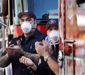 As the COVID-19 virus courses through America's heartland and beyond, it's time fire service leaders make our own course correction. (AP Photo/Elaine Thompson)