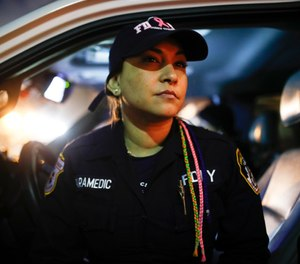 FDNY Paramedic Elizabeth Bonilla sits in her ambulance between calls on April 15, 2020, in the Bronx. Bonilla is one of four EMS providers who claim in a lawsuit the FDNY violated their First Amendment rights by retaliating against them after they spoke publicly during the COVID-19 pandemic. (AP Photo/John Minchillo)