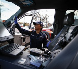 FDNY paramedic Elizabeth Bonilla strictly disinfects her ambulance prior to a double shift at EMS Station 3, Wednesday, April 15, 2020, in the Bronx borough of New York.