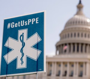 Advocacy groups displayed signs that read #GetUsPPE on the West Lawn of the U.S. Capitol, Friday, April 17, 2020, in Washington. The NAEMT has announced a