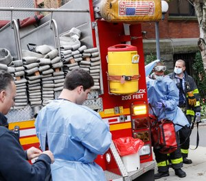 When COVID-19 prevents firefighters and EMTs from filling their roles, who fills the gap? The answer, time and again, is volunteers. (AP Photo/John Minchillo)