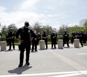 Members of the Los Angeles Police Department thank hospital workers after an officer was treated and recovered from COVID-19, Friday, April 17, 2020, outside Providence St. John's Medical Center in Santa Monica, Calif. (AP Photo/Marcio Jose Sanchez)