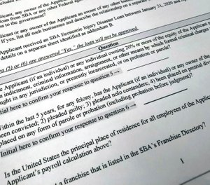 Shown is a portion of a Small Business Administration Paycheck Protection Program Borrower Application Form, Tuesday, April 21, 2020 in Washington. Hidalgo County EMS, South Texas' largest ambulance provider, says it has difficulty finding a lender due to its bankruptcy status. (AP Photo/Wayne Partlow)