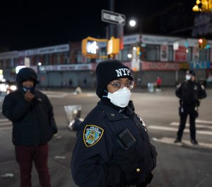 Police officers patrol a quiet street on foot Wednesday night, April 22, 2020, during the coronavirus pandemic, in the Bronx borough of New York. (Photo/TNS)
