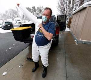 Biohazard cleaner Jamie Milliken suits up to clean a cell in the jail at the Wheat Ridge, Colo., Police Department. What would your facility do if outside cleaning contractors no longer responded during COVID-19?(AP Photo/David Zalubowski)