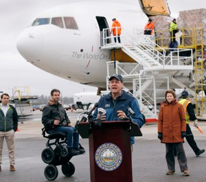 New Hampshire Governor Chris Sununu addresses the media as PPE is unloaded from a cargo plane on April 30. Sununu announced on Monday, May 4 that New Hampshire first responders will be eligible for up to $300 weekly through CARES Act funds received by the state.