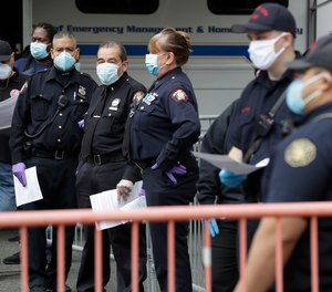 First responders wait in line to be tested for coronavirus antibodies at a testing site in Jersey City, N.J., Monday, May 4, 2020. Villanova University's M. Louise Fitzpatrick College of Nursing in Pennsylvania has launched the CHAMPS Caring about Health for All study to assess the short- and long-term impacts of the pandemic on first responders' and healthcare workers' physical and mental health.