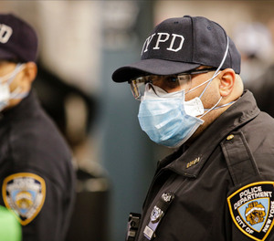 New York Police officers clear trains at the Coney Island Stillwell Avenue Terminal, Tuesday, May 5, 2020, in the Brooklyn borough of New York.