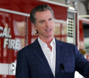 In this May 13, 2020 photo, California Gov. Gavin Newsom discusses the state budget during a news conference at the CAL FIRE/Cameron Park Fire Station. California's state firefighters' union has agreed this week to a 7.5% pay cut for state firefighters after negotiations with Newsom's administration. (AP Photo/Rich Pedroncelli)