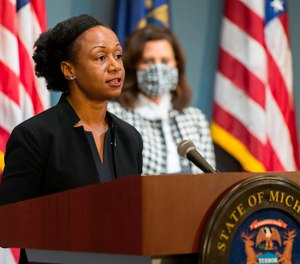 Michigan's Chief Medical Executive Dr. Joneigh Khaldun (left) urged residents not to delay medical treatment after the state saw a 62% increase in out-of-hospital deaths during the pandemic. (AP Photo/Michigan Executive Office of the Governor via AP)