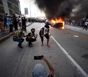 An Atlanta Police Department vehicle burns after George Floyd protests turn violent, Friday, May 29, 2020, in Atlanta.