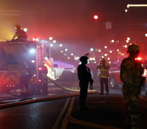 "As an agency and industry that operates under paramilitary rules and regulations, and often grouped with law enforcement as ""first responders,"" fire departments and individual firefighters have a unique perspective on law enforcement. (AP Photo/Julio Cortez)"