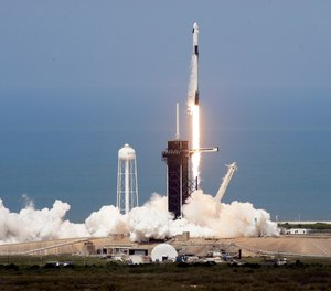 A SpaceX Falcon 9, with NASA astronauts Doug Hurley and Bob Behnken in the Dragon crew capsule, lifts off from Pad 39-A at the Kennedy Space Center in Cape Canaveral, Fla., Saturday, May 30, 2020.