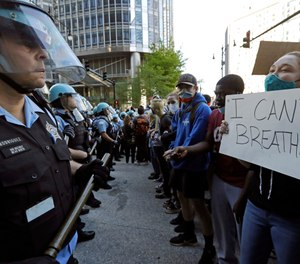 People confront police officers during a protest over the death of George Floyd in Chicago, Saturday, May 30, 2020. (AP Photo/Nam Y. Huh)