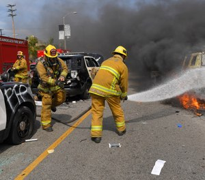 The public trust is rooted in the idea that firefighters are not only held to a higher standard, but also expected to perform at a higher level, both in terms of performance and accountability. (AP Photo/Mark J. Terrill)