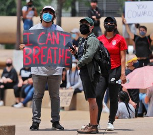 Protesters gather in front of Dallas City Hall, Tuesday, June 2, 2020. EMS providers across the country are grappling with the uncharted territory of facing a pandemic and civil unrest at the same time. (AP Photo/LM Otero)