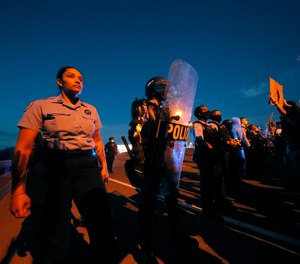 Who is taking care of the cops when they are enduring hatred, betrayal and intense scrutiny? (AP Photo/Gerald Herbert)