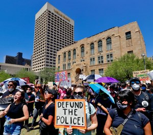 Protesters rally Wednesday, June 3, 2020, in Phoenix, demanding that the Phoenix City Council defund the Phoenix Police Department. (AP Photo/Matt York)