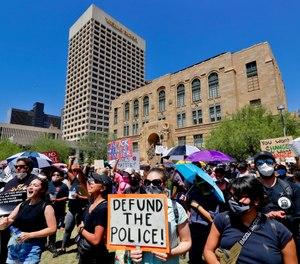 Protesters rally Wednesday, June 3, 2020, in Phoenix, demanding that the Phoenix City Council defund the Phoenix Police Department. (AP Photo/Matt York)