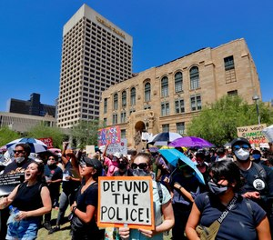 Protesters rally Wednesday, June 3, 2020, in Phoenix, demanding that the Phoenix City Council defund the Phoenix Police Department.