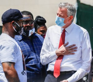 Terrence Floyd, brother of the deceased George Floyd, speaks with New York City Mayor Bill de Blasio, right, during a rally in Brooklyn, Thursday, June 4, 2020(AP Photo/John Minchillo)