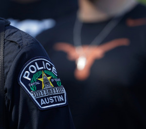 Members of the Austin police department march with members of the University of Texas football team to the State Capitol on Thursday, June 4, 2020, to protest the death of George Floyd.