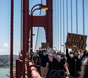 Protestors demonstrate on the Golden Gate Bridge in Francisco, California on June 6, 2020.