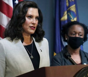 Michigan Gov. Gretchen Whitmer addresses the state during a speech in Lansing, Mich., Wednesday, June 17, 2020. A supplemental funding bill negotiated between Whitmer and state lawmakers will provide state departments with an additional $880 million.