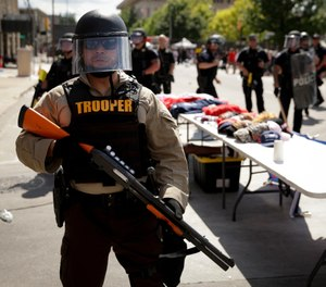 The use of less-lethal devices by police during protests and riots is attracting a lot of attention from legislators, the media and the public. (AP Photo/Charlie Riedel, File)