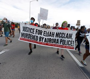 Demonstrators move along Interstate 225 during a rally and march over the death of 23-year-old Elijah McClain Saturday, June 27, 2020, in Aurora, Colo.