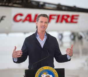 California Gov. Gavin Newsom visits the California Department of Forestry and Fire Protection's McClellan Reload Base in Sacramento, Calif., Thursday, July 9, 2020, to discuss the state's new efforts to protect emergency personnel and evacuees from COVID-19 during wildfires. (AP Photo/Hector Amezcua)