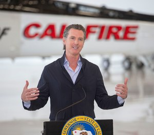 California Gov. Gavin Newsom visits the California Department of Forestry and Fire Protection's McClellan Reload Base in Sacramento, Calif., Thursday, July 9, 2020, to discuss the state's new efforts to protect emergency personnel and evacuees from COVID-19 during wildfires.