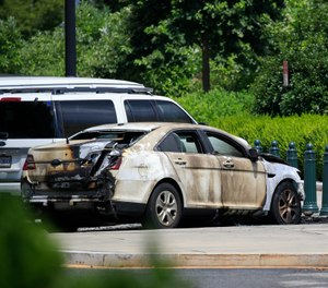 A look at the unmarked police car that was set on fire near the Supreme Court in Washington, Wednesday, July 15, 2020. (AP Photo/Pablo Martinez Monsivais)