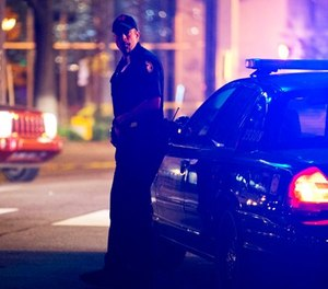 A police officer stands near the scene of an officer-involved shooting, Tuesday, Dec. 1, 2015, in downtown Atlanta.