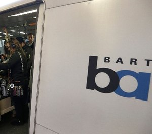 In this Oct. 22, 2013 file photo, Bay Area Rapid Transit passengers wait for a BART train to depart the Fruitvale station in Oakland, Calif.  (AP Photo/Ben Margot, File)