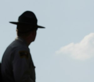 The case of a North Carolina State Trooper's missing hat has wound its way up and down the state's courts. (AP Photo/Charlie Riedel)