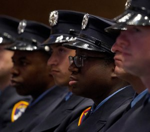 Firefighters participate in a fire department graduation ceremony, Thursday, Dec. 5, 2013 in the Brooklyn borough of New York. (AP Photo/Mark Lennihan)