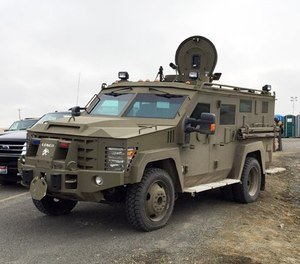 Armored vehicle known as a Bearcat blocks the road to the Malheur Wildlife Refuge at an FBI checkpoint outside of Burns, Ore., Friday, Feb. 12, 2016.