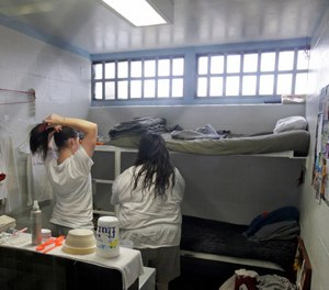 Female inmates interact in their cell at the Timpanogos Women's Correctional Unit during a media tour Thursday, Feb. 26, 2015, at the Utah State Correctional Facility in Draper, Utah. (AP Photo/Rick Bowmer, Pool)